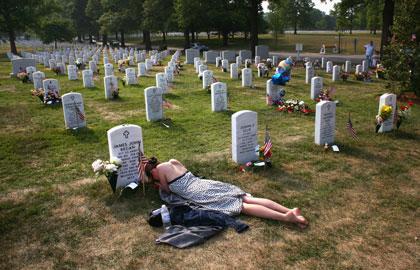 http://thejaghunter.files.wordpress.com/2011/05/girl-laying-before-gravestone-arlington.jpeg